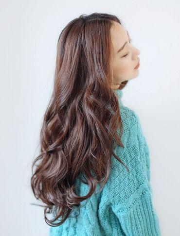 Korean girl with dark brown wavy hair