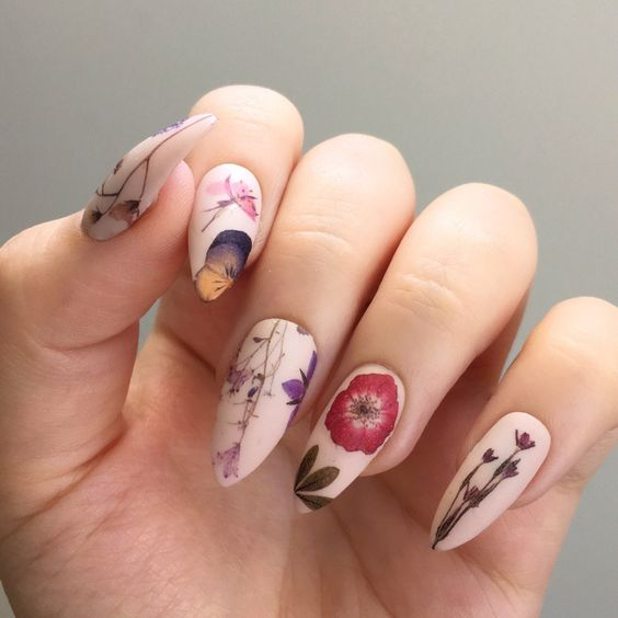 nude pointed nails with dried flowers painted on