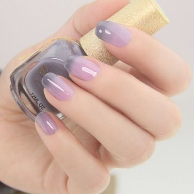 candy-inspired pastel nail art in purple