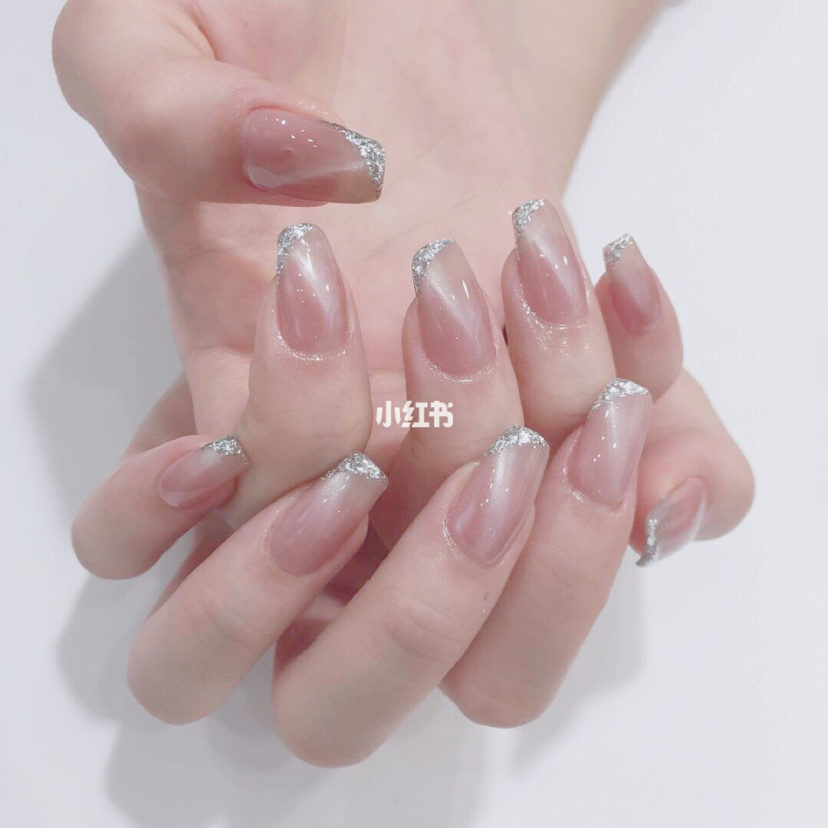 Light pink with silver tips cat eye nails