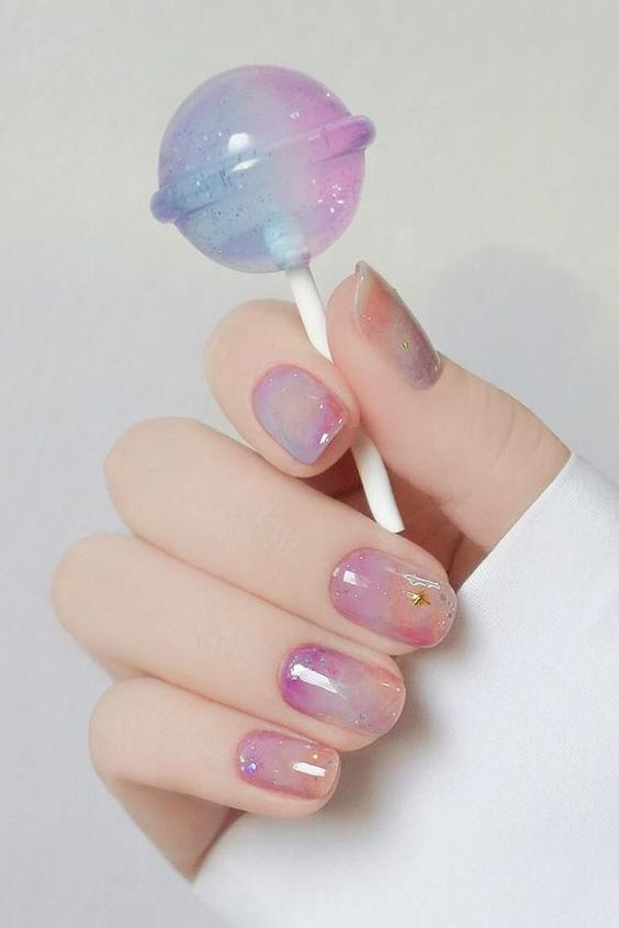 candy-inspired pastel nail art with a lolipop