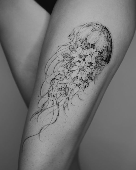 outer thigh tattoo