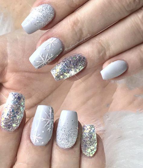 Silver snowflake nail design