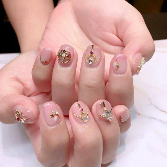 Sailor Moon-Inspired Nail Art with a nude nail base