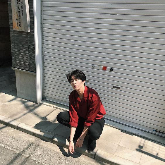 asian guy striking an easy and effortless pose