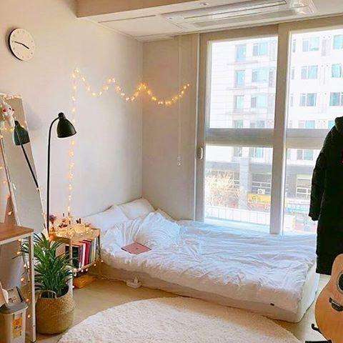 Korean-style bedroom interior design minimalist with fairy lights