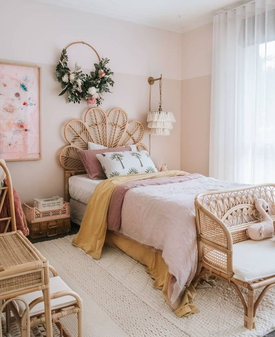 rattan bed frame, wreath and white rug in bedroom