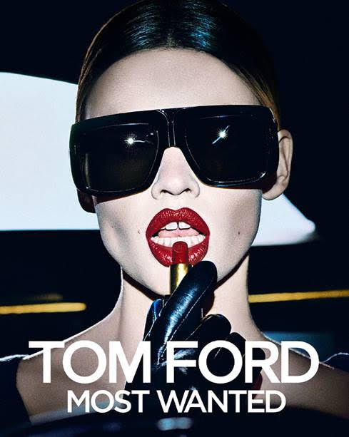 model wearing sunglasses and Tom Ford Most Wanted Lip Colours