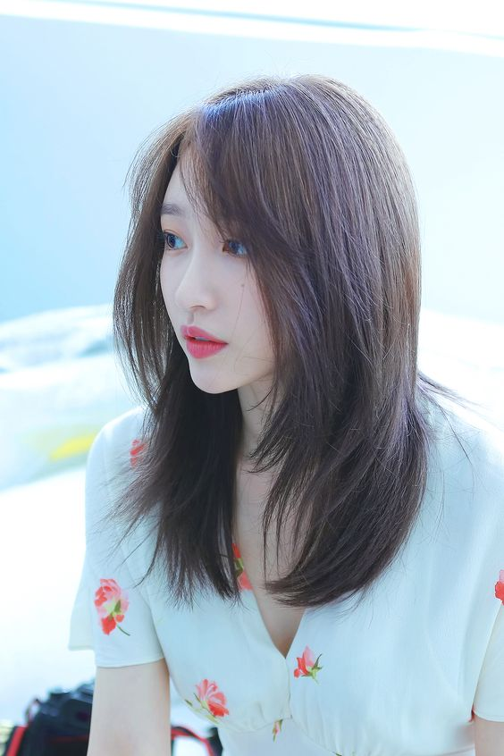 Hani with straight shoulder length hairstyle