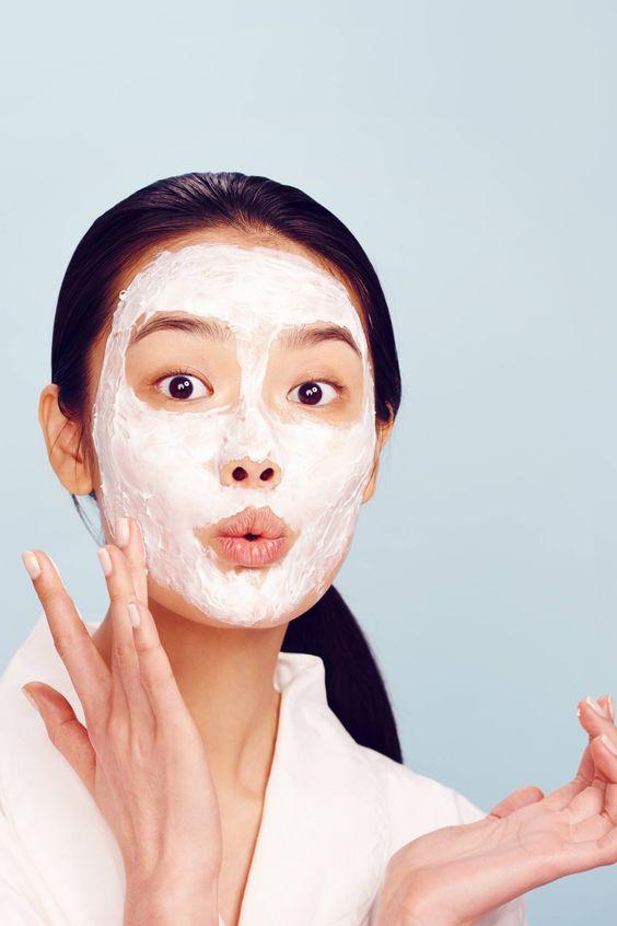 Girl applying mask on her face