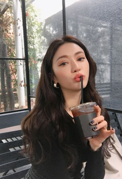 korean model with a drink and straw