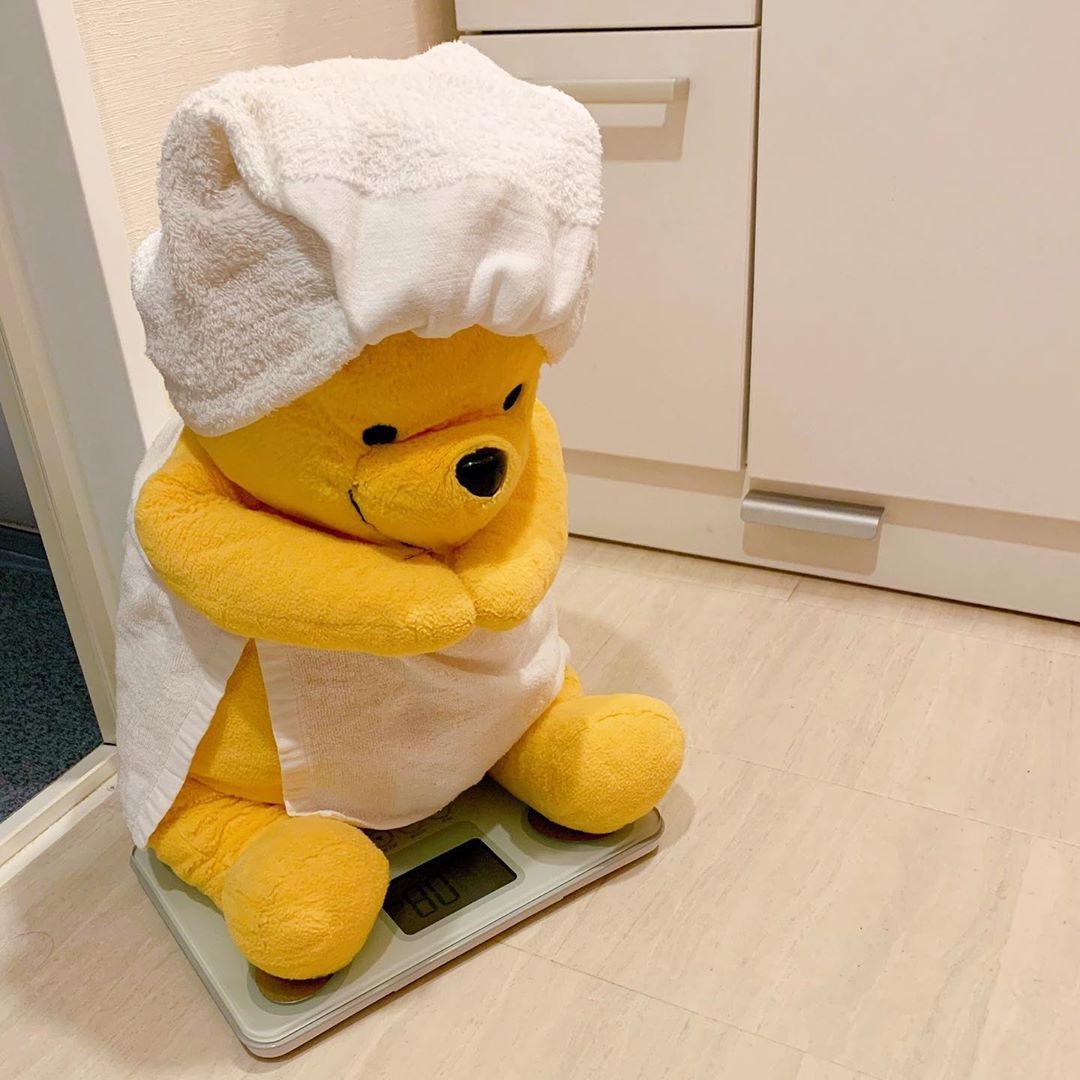 winnie-the-pooh plush toy daily life checking weight on weighing machine