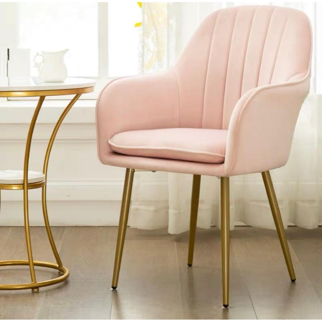 Pink velvet chair with armrest and golden legs