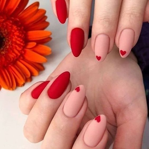Red heart-shaped nail design