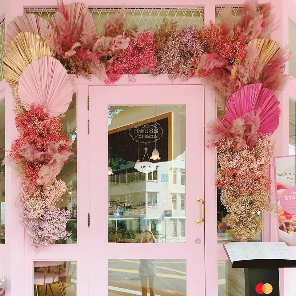 Little House of Dreams pink doorway with flowers