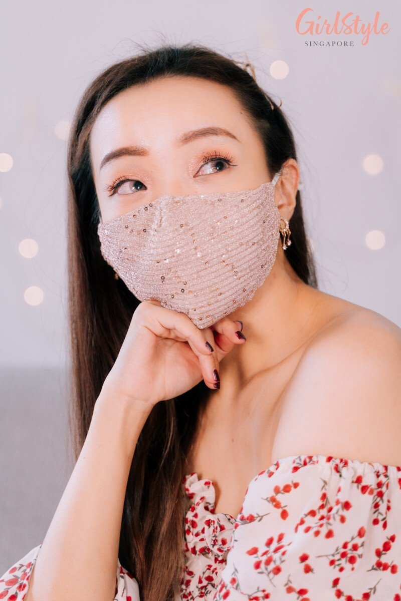 asian girl wearing a glittery sparkling face mask