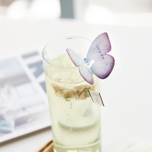 kKKOKDAM purple butterfly tea bag in glass
