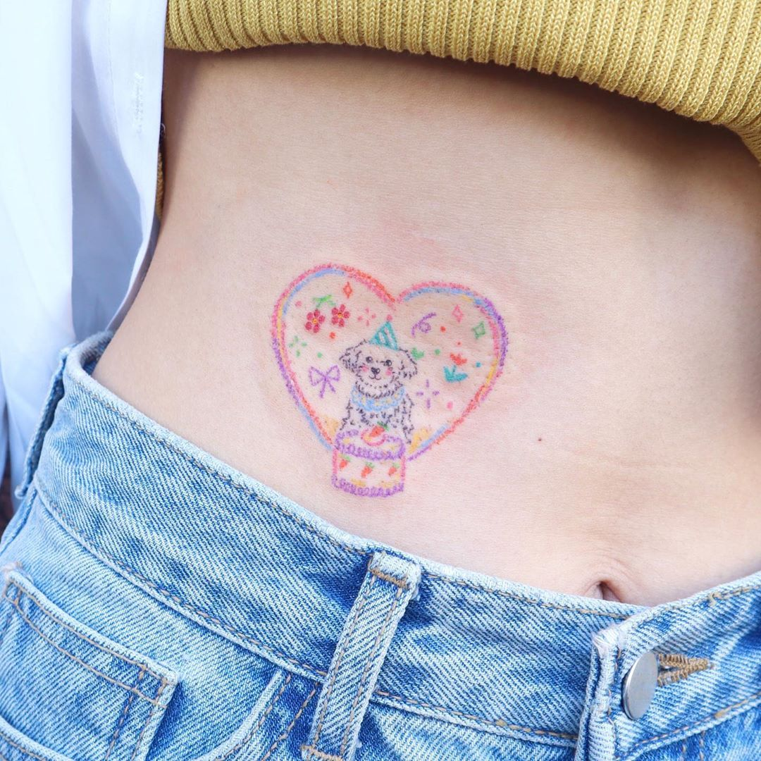 delicate pastel dog in heart tattoo