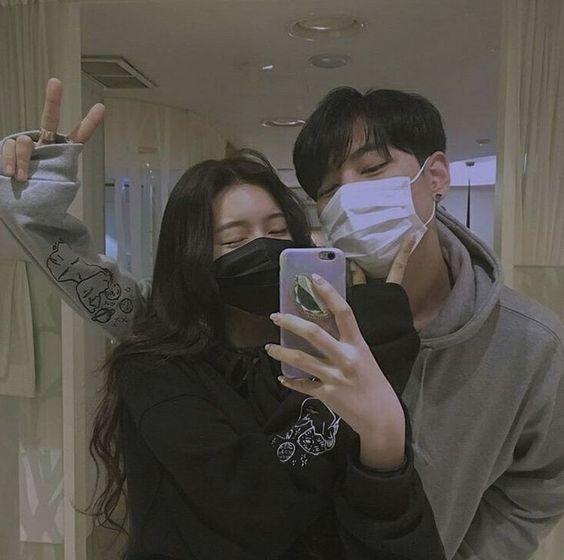 Couple taking mirror selfie