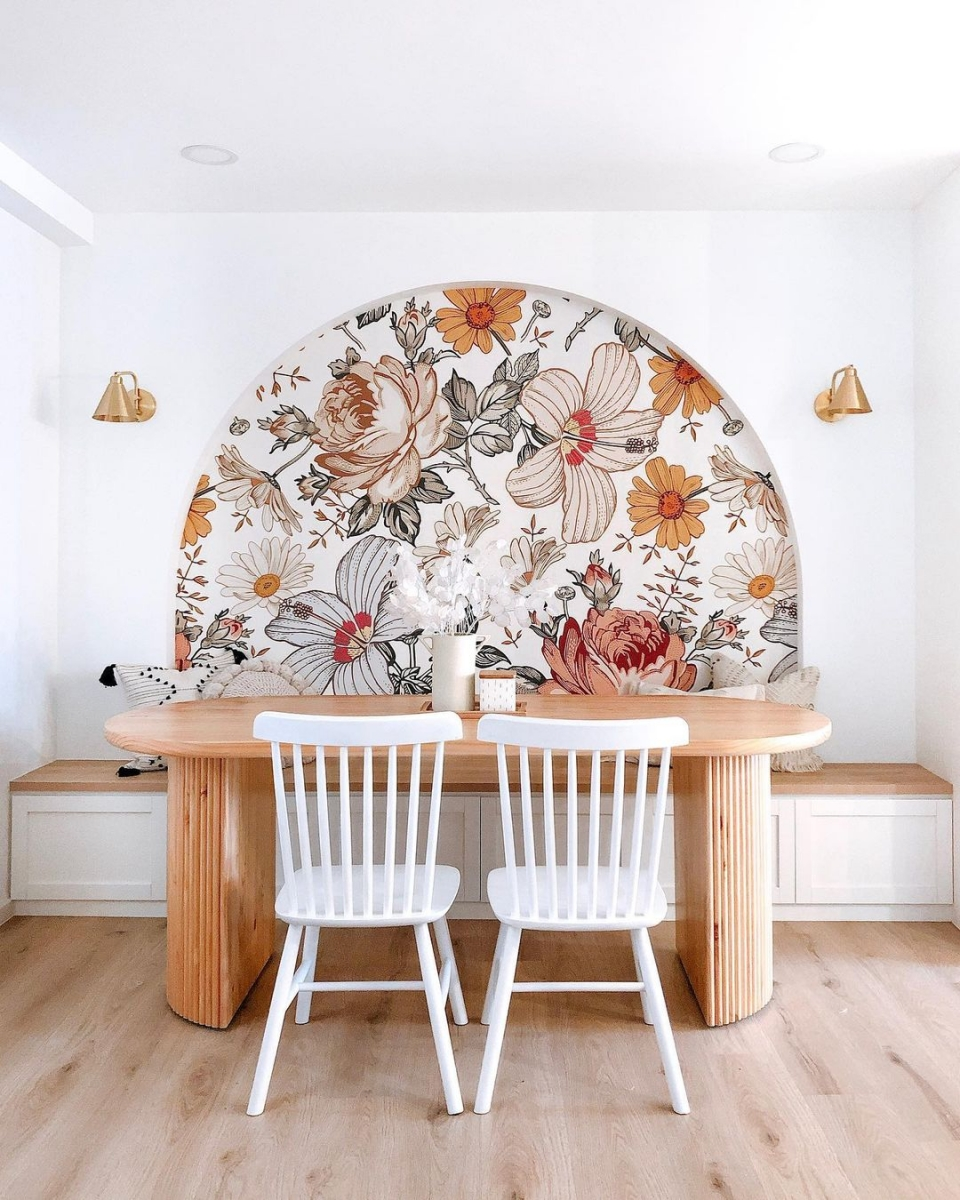 breakfast dining nook in singapore with floral arch and wood table