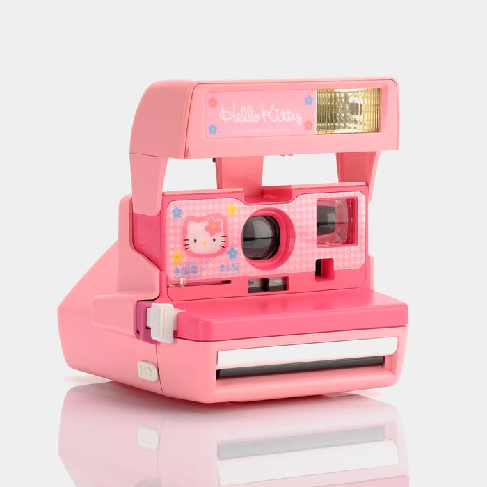 pink Hello Kitty Polaroid 600 camera