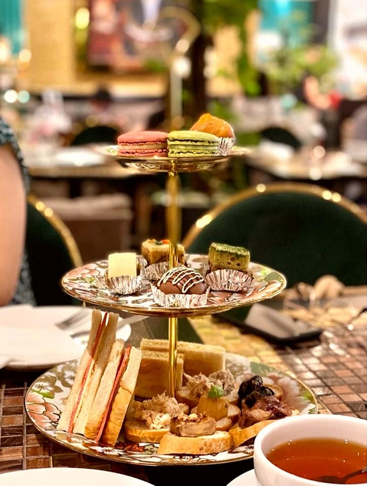 three tier stand high tea at wonderland savour Alice In Wonderland-Themed Restaurant In Singapore