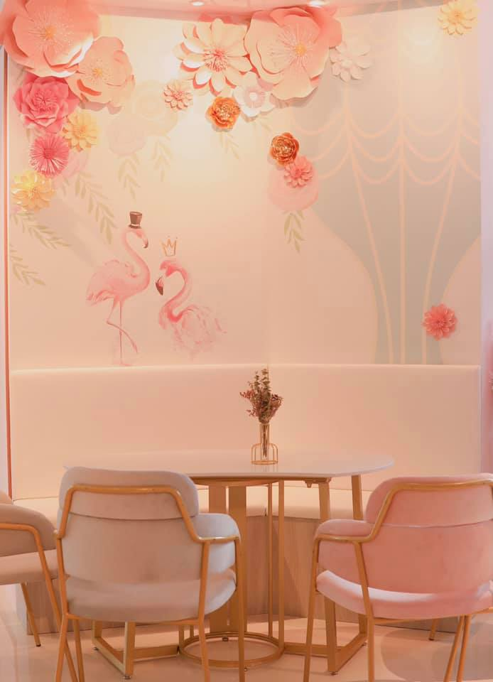 YTEA pink bubble tea cafe with floral wall