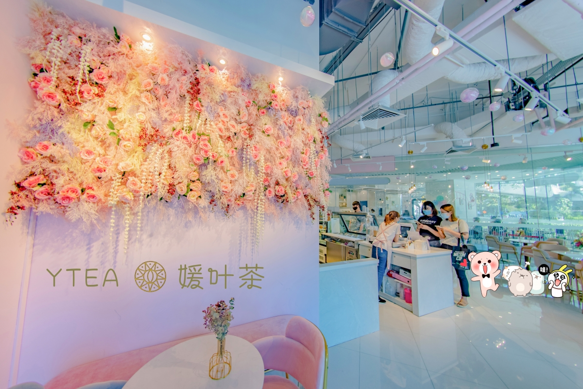floral wall at YTEA pink bubble tea cafe
