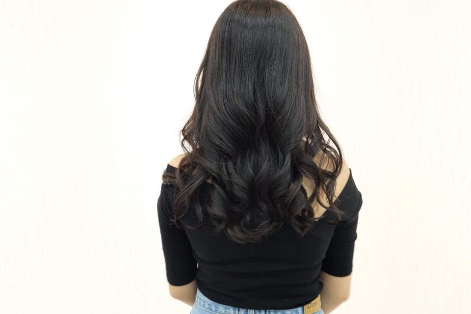 black permed curly hair at NAOKI Hair Dressing