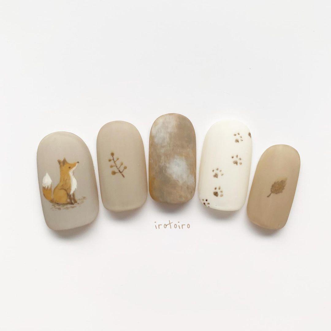 japanese autumn-themed fox nails